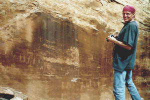 Jim Jacobs at rock art site in Utah.