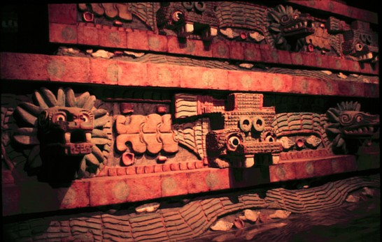 Quetzalcoatl pyramid facade with tlaloc and serpent masks.